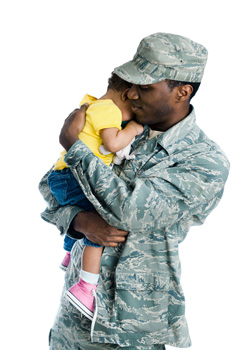 Military soldier dad in uniform holding a child